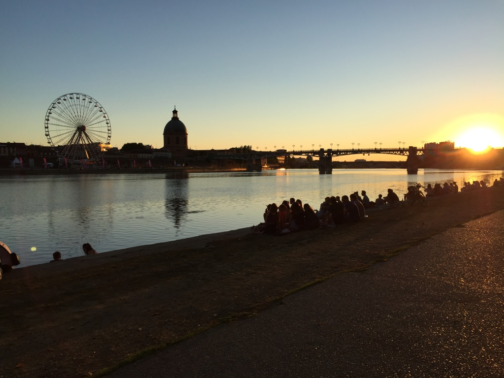 The river Garonne.  The river side is the heart of the city. Many people gather there, having different kind of activity (e.g. music, dancing, talking, drinking, picnic, etc.), and also enjoying the splendid view of the sunset.